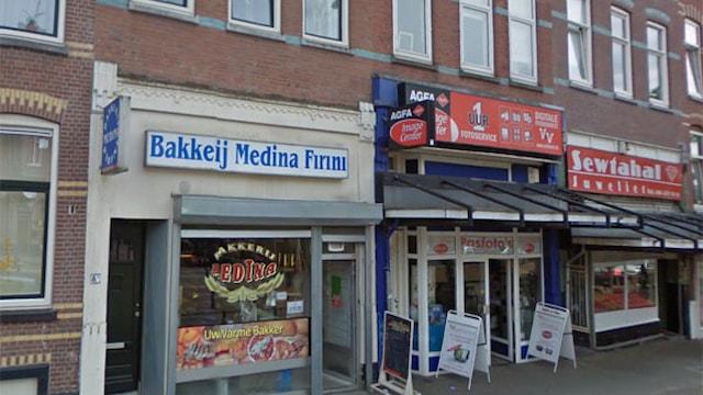 Winkelruimte met bovenwoningen aan de Vierambachtsstraat te Rotterdam