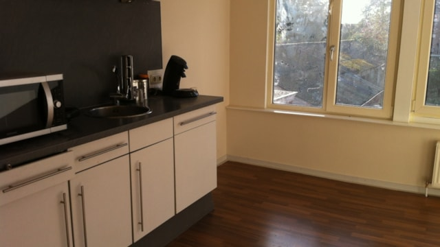 Eerste verdieping woonkamer met open keuken